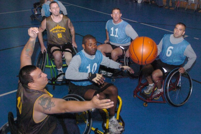 'Hooping' For a Cause: Wheelchair Basketball Challenges Fort Hood Warriors in Transition