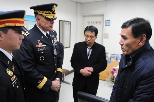 Lt. Gen. John D. Johnson, 8th Army commanding general, talks with the father of a wounded Republic of Korea Marine at the memorial service for the two ROK Marines killed during North Korea's unprovoked artillery attack on Yeonpyeong Island.