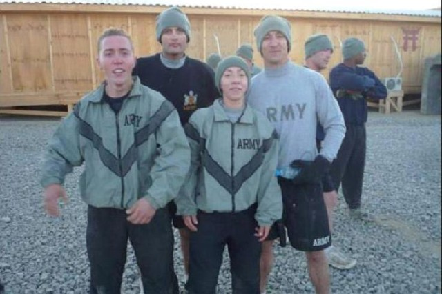 GHAZNI PROVINCE, Afghanistan - The top finishers from the Forward Operating Base Andar portion of the Turkey Trot five-kilometer race wait to receive their awards Nov. 20. From left: U.S. Army Sgt. Kevin Thaden from Portland, N.Y., a scout from 3rd Battalion, 187th Infantry Regiment; U.S. Army Staff Sgt. Kenneth Deldeo from Province, R.I., an artilleryman with Company D, 1st Bn., 321st Artillery Regt.; U.S. Army Pfc. Lizeth Wakasa from West New York, N.J., with Forward Support Company, 3rd Bn., 187th Inf. Regt.; U.S. Army Spec. Derek Deboisbrand from Boston with D Co., 1st Bn., 321st Artillery Regt. Deboisbrand was the overall winner, with a time of 19 minutes, 42 seconds.  (Photo by U.S. Army Capt. Michael Naas, Task Force Iron Rakkasan Headquarters Company commander)