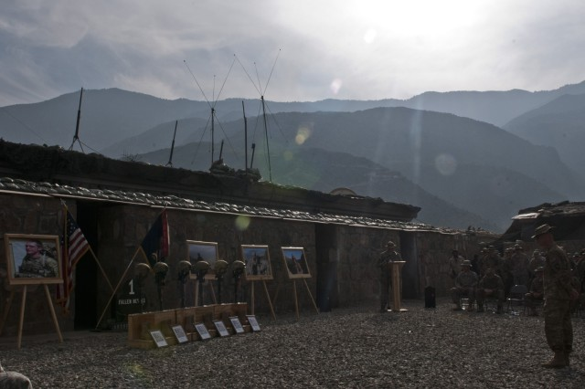 KUNAR PROVINCE, Afghanistan - The sun shines down from the mountains during a memorial service for six fallen Soldiers from Task Force Bulldog at Combat Outpost Honikker Miracle in eastern Afghanistan's Kunar Province Nov. 21. The Soldiers were all attached to Abu Company, 1st Battalion, 327th Infantry Regiment, 1st Brigade Combat Team, 101st Airborne Division. (Photo by U.S. Army Staff Sgt. Mark Burrell, Task Force Bastogne Public Affairs)