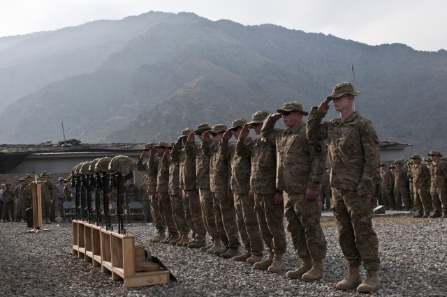KUNAR PROVINCE, Afghanistan - Soldiers assigned to Abu Company, 1st Battalion, 327th Infantry Regiment (Task Force Bulldog), 1st Brigade Combat Team, 101st Airborne Division, render a final salute to their six fallen brethren during a memorial service at Combat Outpost Honikker Miracle in eastern Afghanistan's Kunar Province Nov. 21. The six Soldiers died in combat Nov. 14 during Operation Bulldog Bite. (Photo by U.S. Army Staff Sgt. Mark Burrell, Task Force Bastogne Public Affairs)