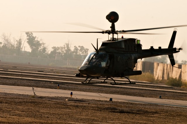 A Kiowa Warrior helicopter lifts off from Camp Taji, Iraq, to conduct a scout and reconnaissance mission in the Baghdad area. The helicopter belongs to the 1st Squadron, 6th Cavalry Regiment, a squadron from the Enhanced Combat Aviation Brigade, 1st Infantry Division, the Army's only aviation brigade in Iraq. (U.S. Army photo by Spc. Roland Hale, eCAB, 1st Inf. Div. PAO)