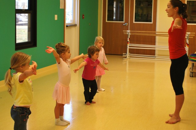 Vickie Woods, far right, instructs her students through a ballet routine Nov. 10 during the SKIES class at the Forsyth East Child Development Center, Fort Riley. SKIES offers a range of activities for children six months to 18 years of age.