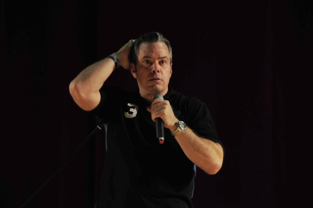 """Bernie McGrenahan performs his """"Happy Hour"""" comedy routine at the Tower Theater, Nov. 16, to more than 500 Soldiers. For nearly an hour, Soldiers laughed at McGrenahan's stand-up routine and learned an important lesson on the dangers of drugs and alcohol."""