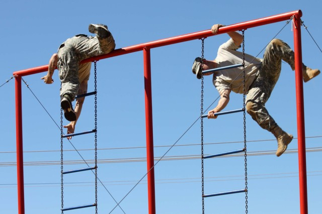 New York Army National Guard Pvt. 1st Class Michael Ellsworth (left) and Staff Sgt. Jeffrey Dorvee negotiate the ladder obstacle while competing in the South African National Military Stakes Competition, November 8-13, 2010. Five members of Company C 2nd Battalion, 108th Infantry, based in Gloversville, New York, represented the U.S. Army at the annual event.