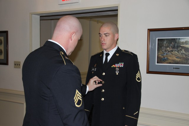 Staff Sgt. James Harris' uniform is inspected by his sponsor Staff Sgt. Christopher Barber just before his Command Sergeants Major Board appearance during the Department of the Army's Best Warrior Competition at Fort Lee, Va., Oct. 17-22.