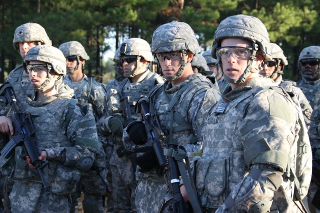 Staff Sgt. James Harris, front center, and Spec. Matthew McLeod, front right, prepare for a situational training exercise in an urban environment during the Department of the Army's Best Warrior Competition at Fort Lee, Va., Oct. 17-22.