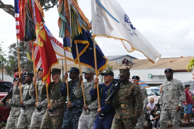 The Joint Forces Color Guard marches at the head of the Wahiawa Lions' 65th Annual Veterans' Day Parade Nov 11.