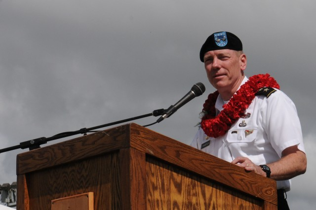 Maj. Gen. Bernard Champoux, keynote speaker, addresses the Wahiawa Lions' 65th Annual Veterans' Day Parade participants and crowd.