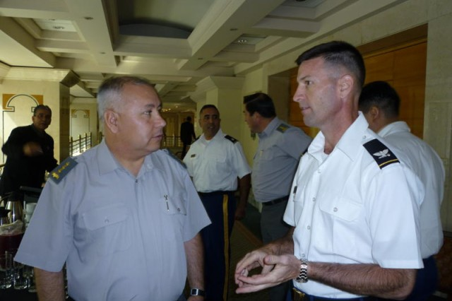 Col. Brian McNaughton, director of the security cooperation division Army South, talks with a fellow delegate Col. Felipe Robledo, from the Chilean army's intelligence directorate.