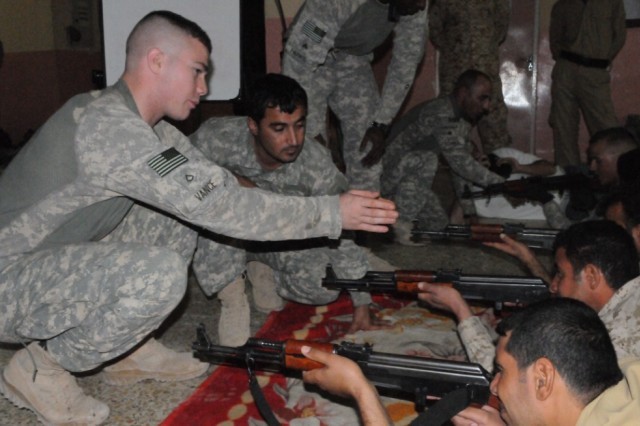 BASRA PROVINCE, Iraq - Pfc. Cody Vance of Elkhart, Ind., cavalry scout, Troop B, 4th Sqdn., 10th Cav. Reg., 3rd AAB trains troops from 4th Company, 2nd Battalion, 9th Brigade, 4th Region, Department of Border Enforcement with their basic rifle marksmanship.