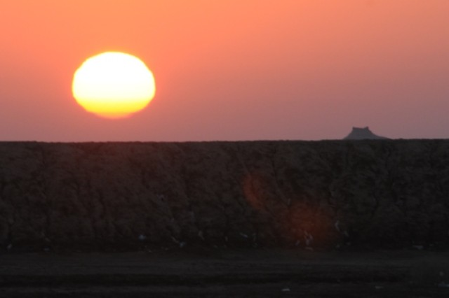 The morning sun, as viewed from a 4th Region, Department of Border Enforcement outpost, creeps over the Iranian side of the border shared with Iraq.  Police assigned to the 4th Region, DBE man outposts along the border as they provide for the security and sovereignty of the Iraqi borders.