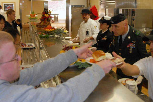 PRESIDIO OF MONTEREY, Calif. - Presidio service leaders take part in the traditional serving of the Thanksgiving meal here Nov. 25.