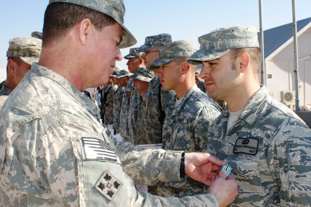 Army general awards Airman on Thanksgiving Day