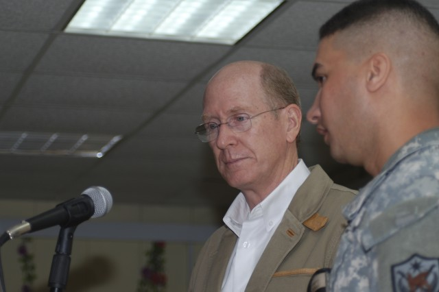 101118-A-1121F-001.jpg - BAGHDAD - Peter Fischer, director of Iraq Training and Advisory Mission-Intelligence and a resident Fairfax, Va., addresses Iraqi Army Intelligence school graduates, at Camp Taji Nov. 15. This class, of 305 students, was the first time Regional Guard Brigade Soldiers participated with Iraqi Army Soldiers at the school, and marked the successful integration of 37 RGB Soldiers into the program.