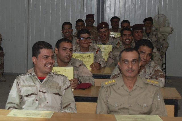 101118-A-1121F-004.jpg - BAGHDAD - Regional Guard Brigade Soldiers are now fully integrated with Iraqi Army Soldiers at the Iraqi Army Intelligence School at Camp Taji. A graduation ceremony at the school Nov. 15 marked the successful completion of the school's first class to contain RGB Soldiers.