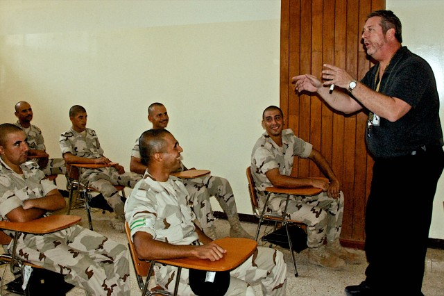 Jeff Turley, an English teacher who calls Hat Yai Thailand home, introduces himself to a group of cadets at the Iraqi Military Academy at Rustamiyah during an orientation session Nov. 2. He is one of seven USF-I English Language Training Program teachers who will be teaching students at IMAR.
