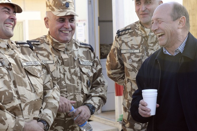 KANDAHAR AIRFIELD, Afghanistan -- Romanian President Traian Basescu meets with Romanian soldiers at Forward Operating Base Apache, near Qalat in Zabul province, as a visit to hear from his near 1,650 troops throughout Afghanistan. Romania joined NATO in 2004 and has since been a player in operations in the Middle East and southwest Asia.