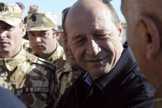 KANDAHAR AIRFIELD, Afghanistan -- Romanian President Traian Basescu meets with Romanian soldiers at Forward Operating Base Apache, near Qalat in Zabul province, to hear from his troops throughout Afghanistan. Romania joined NATO in 2004 and has since been a player in operations in the Middle East and southwest Asia.