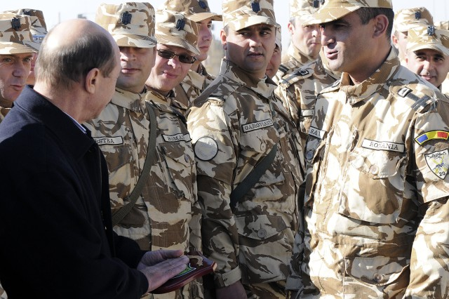 KANDAHAR AIRFIELD, Afghanistan -- Romanian President Traian Basescu meets today with Romanian soldiers at Forward Operating Base Apache, near Qalat in Zabul province, as a visit to hear from his near 1,650 troops throughout Afghanistan. Romania joined NATO in 2004 and has since been a player in operations in the Middle East and southwest Asia.