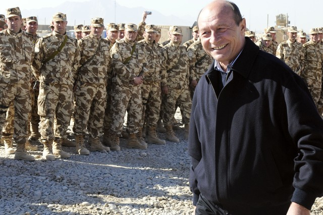 KANDAHAR AIRFIELD, Afghanistan -- Romanian President Traian Basescu meets with Romanian soldiers at Forward Operating Base Apache, near Qalat in Zabul province, as a visit to hear from his troops throughout Afghanistan. Romania joined NATO in 2004 and has since been a player in operations in the Middle East and southwest Asia.