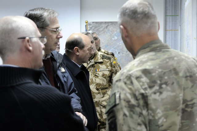 KANDAHAR AIRFIELD, Afghanistan -- Romanian President Traian Basescu meets with Maj. Gen. James L. Terry, Regional Command South commander, to discuss coalition operations in Afghanistan. The visit allowed the Romanian president to meet with more than 150 Romanian soldiers as part of a morale trip to hear from some of his near 1,650 troops throughout Afghanistan. President Basescu also flew to a nearby camp to have lunch with Romanian and coalition forces. Romania joined NATO in 2004 and has since been a player in operations in the Middle East and southwest Asia.