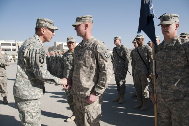 U.S. Army Gen. David H. Petraeus, commander, International Security Assistance Force and commander, U.S. Forces - Afghanistan, congratulations Capt. Brian Knutson, commander of E-Company, 2nd Battalion, 22nd Infantry Regiment, 10th Mountain Division, during a ceremony for the 2-22 at the Kabul Military Training Center, Nov. 27. The ceremony officially present the 2-22, or Triple Deuce, with a Meritorious Unit Commendation for their training role with the Afghan National Army.