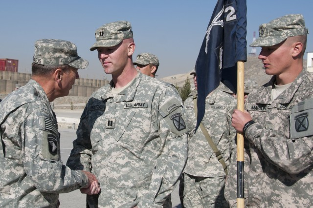 U.S. Army Gen. David S. Petraeus, commander, International Security Assistance Force and commander, U.S. Forces - Afghanistan, congratulates Capt. Brian Retherford, 2nd Battalion, 22nd Infantry Regiment, 10th Mountain Division, during a ceremony for the 2-22 at the Kabul Military Training Center, Nov. 27. The ceremony officially present the 2-22, or Triple Deuce, with a Meritorious Unit Commendation for their training role with the Afghan National Army.