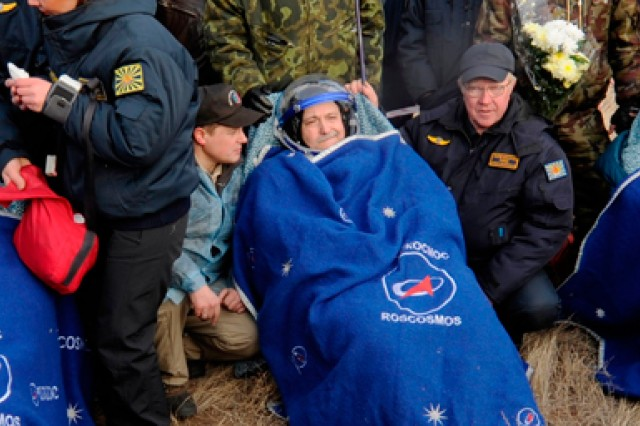 NASA International Space Station Commander and Army Col. Doug Wheelock, along with NASA Flight Engineer Shannon Walker and Expedition 25 Soyuz Commander Fyodor Yurchikhin, landed safely on the steppe of Kazakhstan Nov. 26. They are shown being assisted by Russian personnel into reclining chairs to begin their adaptation to gravity after being extracted from their capsule.