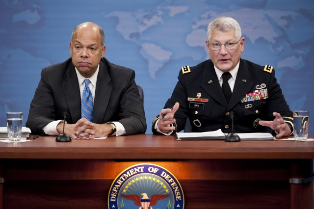 """Department of Defense General Counsel Jeh C. Johnson and U.S. Army Gen. Carter Ham conduct a press briefing at the Pentagon discussing the public release of the """"Don't Ask, Don't Tell"""" Comprehensive Working Group report on Nov. 30,"""