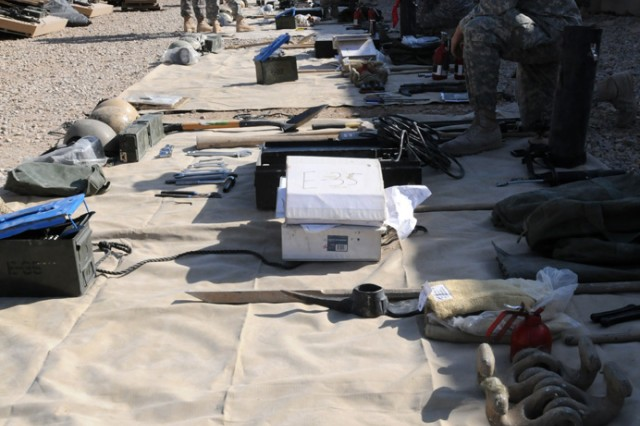 """Soldiers of Troop F, 2nd Squadron, 3rd Armored Cavalry Regiment """"Brave Rifles"""", conduct inventories on Contingency Operating Site Delta. The Soldiers of Fox Troop arrived Nov. 27 in support of Operation New Dawn. The troop will advise and assist Iraqi Security Forces around the province."""