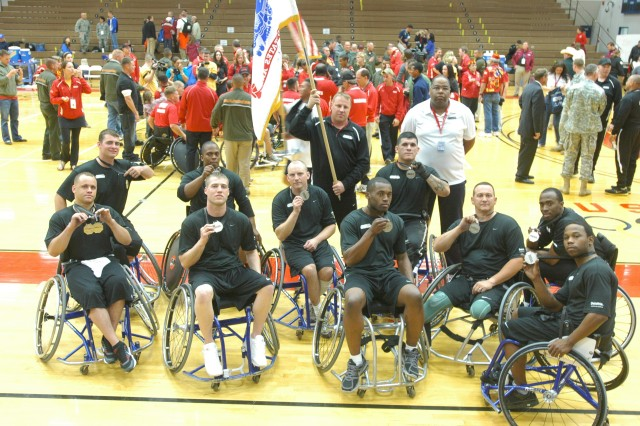 Members of the Army's wheelchair basketball team display their silver medals from their Warrior Games matchup with Marines.