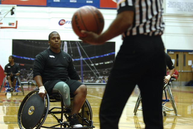 Spc. Craig C. Smith waits at the free throw line for the ball during the gold medal game for wheelchair basketball at the U.S. Olympic Training Center in Colorado Springs, Colo., May 13. The Marines won gold, defeating Army 44-15. The game was part of the inaugural Warrior Games.