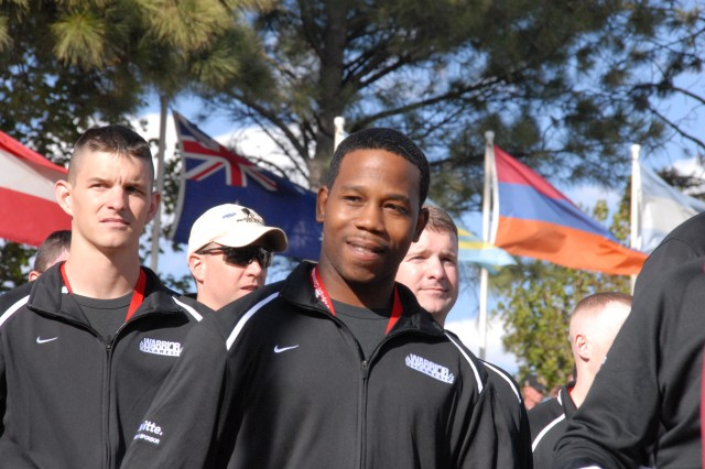 Spc. Filipe Hill and other wounded Soldiers process in to the U.S. Olympic Training Center in Colorado Springs, Colo., during the Inaugural Warrior Games opening ceremonies.