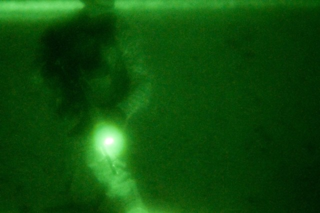 Cpl. Raymond Lamb, a team leader for Company H (Hawk Co.), 3rd Squadron, 2nd Striker Cavalry Regiment, provides security after breaching a compound during a night raid Nov. 22, in the Maiwand District of Afghanistan. Lamb said that security is one of the most important things during assaults.