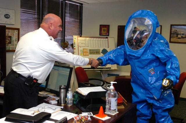 Capt. Jalal Kasaouati of the Moroccan Army (in HAZMAT suit) shakes hands with Richard Brooks III, director of the Cecil County, Md., Department of Emergency Services, during a tour of CBRNE response operations, Nov. 17, 2010.