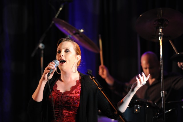 """Vicki Golding, winner of the 2006 Military Idol singing contest, will lead a cast of Soldiers and Veterans from the Army Entertainment Division in a free """"Home for the Holidays"""" concert at 7 p.m. Dec. 4 at the Women in Military Service for America Memorial Gateway to Arlington National Cemetery."""