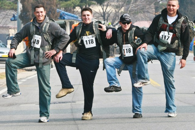 A group of Soldiers take a moment for a light-hearted laugh before crossing the finishline inthe 2010 Warrior Country Rucksack Challenge at Casey Garrison's Carey Physical Fitness Center Nov. 20.