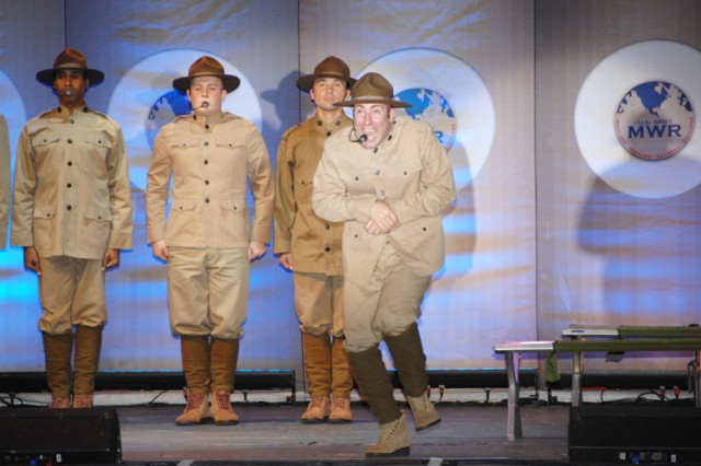 "Pfc. Frank DeLucca (right) from Fort Bragg, N.C. sings ""Oh! I Hate to Get Up in the Morning"" during a special tribute to Irving Berlin - the father of Army entertainment. DeLucca, like Berlin, honed his singing and dancing skills before entering the Army."