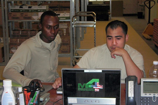 Medical logistics personnel supporting the 21st Combat Support Hospital\'s Medical Supply section use DCAM on the MC4 system to manage supply levels in Mosul, Iraq.