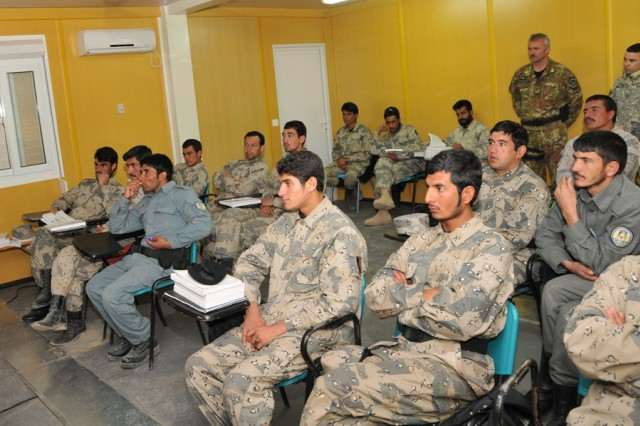 Seventeen  Afghan Border Police recruits listen to a lecture on smuggling versus illegal trafficking at the ABP training compound in Herat Dec. 1. In the classroom, recruits learn: Afghan Constitution, penal codes, criminal codes, customs law, police law, bank law and border policing procedures.