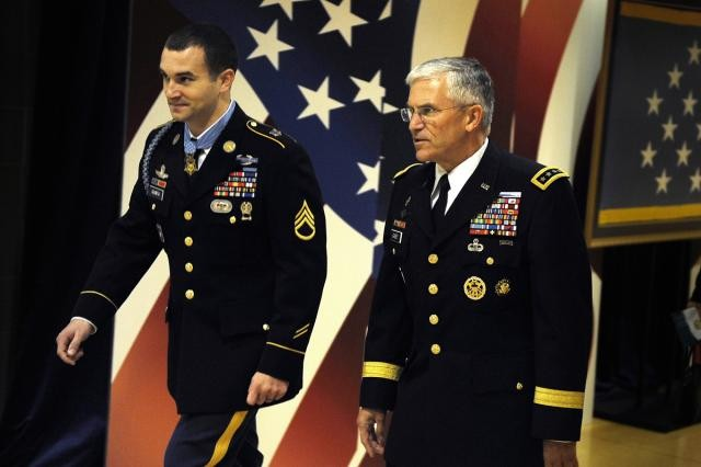 Staff Sgt. Sal Giunta, Medal of Honor recipient, and Gen. George W. Casey, Jr., chief of staff of the U.S. Army, enter the Hall of Heroes at the Pentagon Nov. 17, 2010.  Giunta was inducted into the Hall of Heroes a day after being awarded the nation's highest military honor.