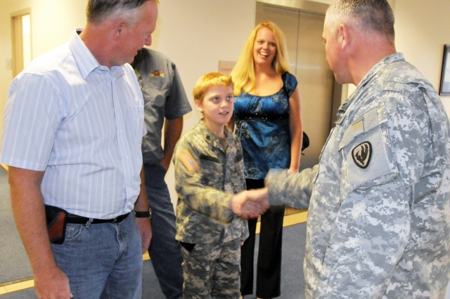 USAACE Aviation Branch Command Sgt. Maj. Tod L. Glidewell meets Westin Pellicer and members of his Family at the headquarters building Nov. 24. Pellicer organized care packages for Soldiers instead of asking for gifts for his 10th birthday in August.