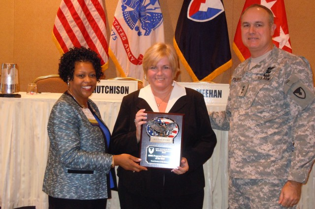 Suzanne Weeks of the U.S. Army Research, Development and Engineering Command was named the Small Business Innovation Research Program Coordinator of the Year. From left to right: Nancy Small, director of AMC's Small Business office; Weeks; Lt. Gen. James H. Pillsbury, deputy commanding general of AMC. U.S. Army Photo by La'Mont Harbison.