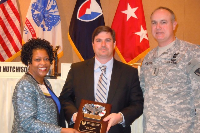 Scott Dennis of the U.S. Army Aviation and Missile Lifecycle Management Command was named the Project Manager of the Year. From left to right: Nancy Small, director of AMC's Small Business office; Dennis; Lt. Gen. James H. Pillsbury, deputy commanding general of AMC. U.S. Army Photo by La'Mont Harbison.