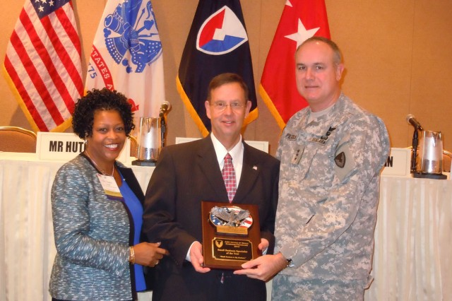 Robert Schrader of the U.S. Army Aviation and Missile Lifecycle Management Command was named Small Business Specialist of the Year. From left to right: Nancy Small, director of AMC's Small Business office; Schrader; Lt. Gen. James H. Pillsbury, deputy commanding general of AMC. U.S. Army Photo by La'Mont Harbison.