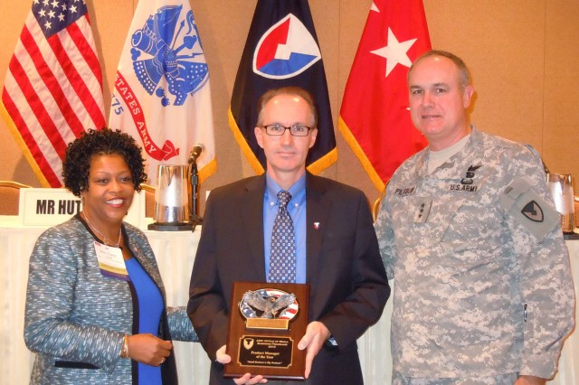 Tracy Mitchell of the U.S. Army TACOM Lifecycle Management Command was named Product Manager of the Year. From left to right: Nancy Small, director of AMC's Small Business office; Mitchell; Lt. Gen. James H. Pillsbury, deputy commanding general of AMC. U.S. Army Photo by La'Mont Harbison.