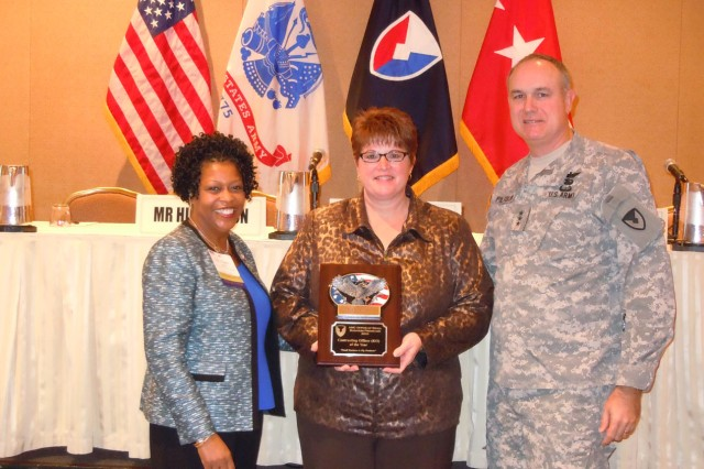 Julie Seaba of the U.S. Army Sustainment Command was named the Contracting Officer of the Year. From left to right: Nancy Small, director of AMC's Small Business office; Seaba; Lt. Gen. James H. Pillsbury, deputy commanding general of AMC. U.S. Army Photo by La'Mont Harbison.