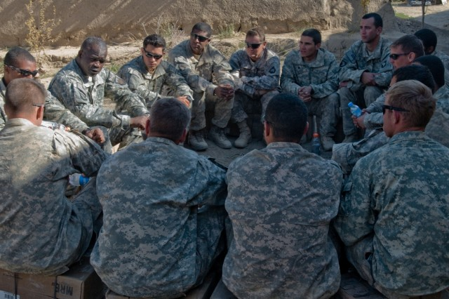 Command Sgt. Maj. Marvin Hill, International Security Assistance Force command sergeant major, speaks with Soldiers from Company A, 1st Battalion, 187th Infantry Regiment, 3rd Brigade Combat Team, 101st Airborne Division (Air Assault) on Thanksgiving in Panjwa'i, Afghanistan. Hill said that he was thankful for each and every Soldier around him because he relies on them to keep him safe. (U.S. Army photo by: SPC Edward Garibay, 16th Mobile Public Affairs Detachment.)