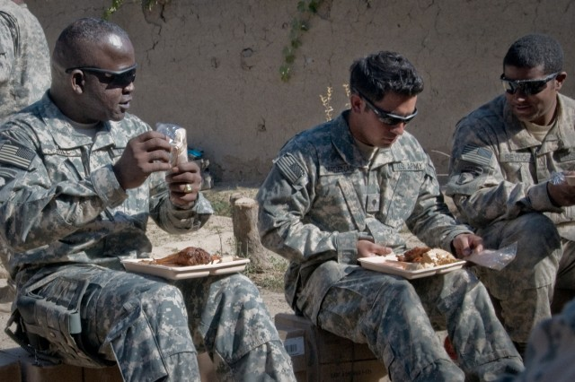 Command Sgt. Maj. Marvin Hill, International Security Assistance Force command sergeant major, eats Thanksgiving dinner with Soldiers from Company A, 1st Battalion, 187th Infantry Regiment, 3rd Brigade Combat Team, 101st Airborne Division (Air Assault) in Panjwa'i, Afghanistan. The visit was a surprise for the Soldiers. (U.S. Army photo by: SPC Edward Garibay, 16th Mobile Public Affairs Detachment.)